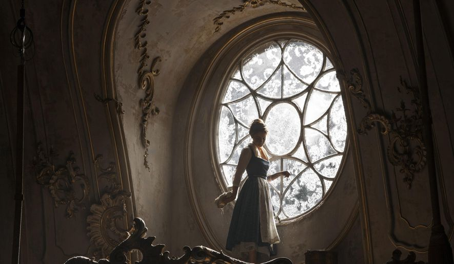 "This image released by Disney shows Emma Watson as Belle in a live-action adaptation of the animated classic ""Beauty and the Beast."" (Laurie Sparham/Disney via AP)"