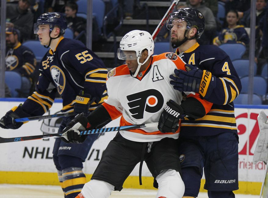 Buffalo Sabres defenseman Josh Gorges (4) and Philadelphia Flyers forward Wayne Simmonds (17) battle for position during the second period of an NHL hockey game, Tuesday, March 7, 2017, in Buffalo, N.Y. (AP Photo/Jeffrey T. Barnes)