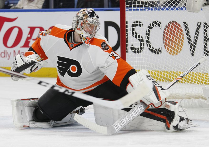 Philadelphia Flyers goalie Steve Mason (35) watches the puck go wide during the first period of an NHL hockey game against the Buffalo Sabres, Tuesday, March 7, 2017, in Buffalo, N.Y. (AP Photo/Jeffrey T. Barnes)