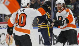 Philadelphia Flyers Jordan Weal (40) and Jakub Voracek (93) celebrate a goal during the second period of an NHL hockey game against the Buffalo Sabres, Tuesday, March 7, 2017, in Buffalo, N.Y. (AP Photo/Jeffrey T. Barnes)