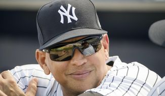 FILE - In this Friday, Feb. 24, 2017, file photo, New York Yankees special advisor Alex Rodriguez speaks with CC Sabathia, who reflected in his sunglasses, ahead of a spring training baseball game against the Philadelphia Phillies in Tampa, Fla. After spending two postseasons as a guest studio analyst for Fox, Rodriquez will stay with the network and add game analyst and feature reporter duties for the network and FS1, the network said Tuesday in announcing a multiyear deal. (AP Photo/Matt Rourke, File)