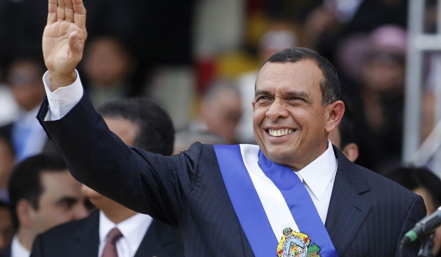 FILE - In this Jan. 27, 2010 file photo, Honduras' President Porfirio Lobo, waves during his presidential inauguration ceremony in Tegucigalpa, Honduras. A man who led a violent Honduran drug trafficking organization has told a New York court on Monday, March 6, 2017, that he bribed the former president and his son to protect his drug trafficking operations and to secure government contracts to help him launder money. The alleged bribes occurred from 2009-2013. (AP Photo/Eduardo Verdugo, File)