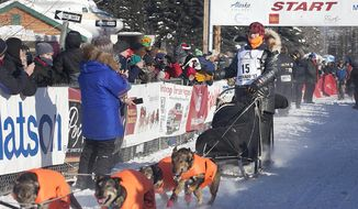 Martin Buser (15) drives his team down the start chute of the 45th Iditarod Trail Sled Dog Race in Fairbanks, Alaska, Monday, March 6, 2017. Buser is one of 5 four-time Iditarod Champions competing in the 2017 Iditarod Trail Sled Dog Race. (AP Photo/Ellamarie Quimby)