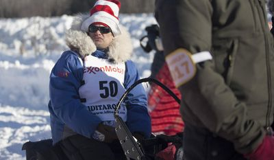 Hugh Neff waits to approach the start line of the 45th Iditarod Trail Sled Dog Race in Fairbanks, Alaska, Monday, March 6, 2017. Neff, the 2012 Yukon Quest champion, often wears a Dr. Seuss hat while mushing to advocate for literacy. (AP Photo/Ellamarie Quimby)