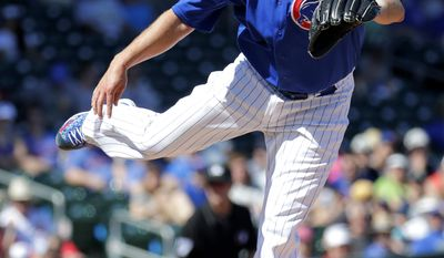 Chicago Cubs pitcher John Lackey throws against Italy during the second inning of an exhibition baseball game, Tuesday, March 7, 2017, in Mesa, Ariz. (AP Photo/Matt York)