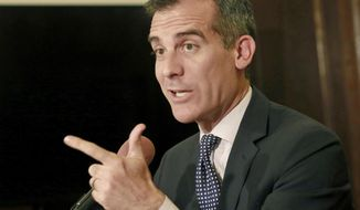 FILE - In this March 2, 2015 file photo, Los Angeles Mayor Eric Garcetti speaks at a news conference in his City Hall office. On Tuesday, March 7, 2017, Los Angeles voters are picking a mayor and could slap restrictions on development in the midst of a building boom. Mayor Eric Garcetti appears on track to earn a return trip Tuesday to City Hall after a low-key campaign against 10 little-known challengers. (AP Photo/Damian Dovarganes, File)