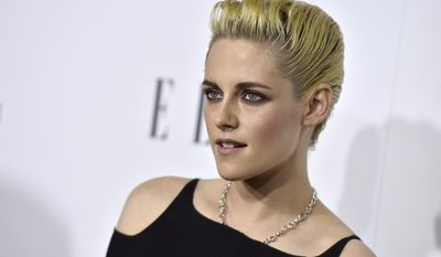 "FILE - In this Oct. 24, 2016, file photo, Kristen Stewart arrives at the 23rd annual ELLE Women in Hollywood Awards at the Four Season Hotel in Los Angeles. Stewart used to fight like heck to keep her private life private, including her relationship with her ""Twilight"" co-star Robert Pattinson, then she came to grips with her celebrity status. The idea, Stewart told People, was to spread acceptance. (Photo by Jordan Strauss/Invision/AP, File)"