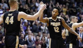 Purdue forward Vincent Edwards, right, celebrates with center Isaac Haas during the second half of an NCAA college basketball game against Northwestern Sunday, March 5, 2017, in Evanston, Ill. Purdue won 69-65. (AP Photo/Nam Y. Huh)