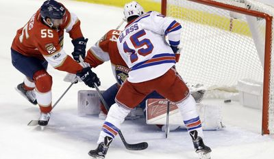 New York Rangers left wing Tanner Glass (15) celebrates after scoring against Florida Panthers goalie James Reimer (34) as Jason Demers (55) defends in the first period of an NHL hockey game, Tuesday, March 7, 2017, in Sunrise, Fla. (AP Photo/Alan Diaz)