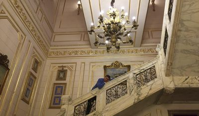 In this photo provided by the Office of the Slovenia's president and used on president's Instagram, Slovenia's president Borut Pahor, poses on the stairs at the King Farouk palace in Cairo, Egypt, Dec. 5, 2016. Donald Trump may rule Twitter, but he's no match for his Slovenian counterpart on Instagram as Slovenia's president Borut Pahor has been actively using social media to get his message across since 2012. (Klemen Horvat/Office of the Slovenia's President via AP)