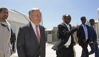 UN Secretary-General Antonio Guterres, centre, walks inside the UN compound during his visit to Mogadishu, Somalia, Tuesday , March 7, 2017.  Guterres is conducting high level talks including with Somalia's new President Mohamed Abdullahi Mohamed, to start of what he calls an emergency visit to highlight the country's famine crisis. (AP Photo/Farah Abdi Warsameh)
