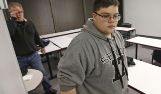 Gloucester County High School senior Gavin Grimm, a transgender student, arrives for a news conference in Richmond, Va., Monday, March 6, 2017. The Supreme Court is handing the Gloucester High School transgender teen's case back to a lower court without reaching a decision. (AP Photo/Steve Helber)