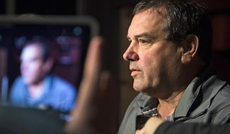 Tennessee's new defensive line coach Brady Hoke speaks to the media during an NCAA college football news conference in the Ray & Lucy Hand Digital Studio on the university's campus in Knoxville, Tenn., on Tuesday, March 7, 2017. (Caitie McMekin/Knoxville News Sentinel via AP)