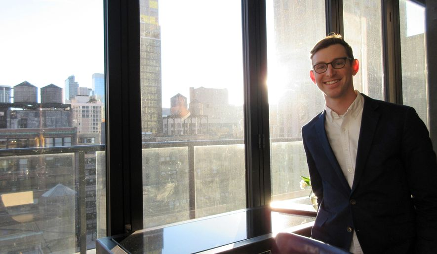 This March 2, 2017 photo shows Lonely Planet CEO Daniel Houghton at a rooftop bar in in New York. Houghton was just 24 when he became head of Lonely Planet in 2013. Since then he's restructured the company, expanded its digital presence and to the surprise of many who feared he'd kill off Lonely Planet guidebooks, he's grown the print side of the business. (AP Photo/Beth J. Harpaz)