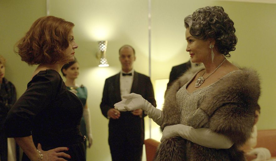 "This image released by FX shows Susan Sarandon as Bette Davis, left, and Jessica Lange as Joan Crawford in a scene from, ""Feud: Bette and Joan,"" premiering on FX Sunday at 10 p.m. EST. (Suzanne Tenner/FX via AP)"