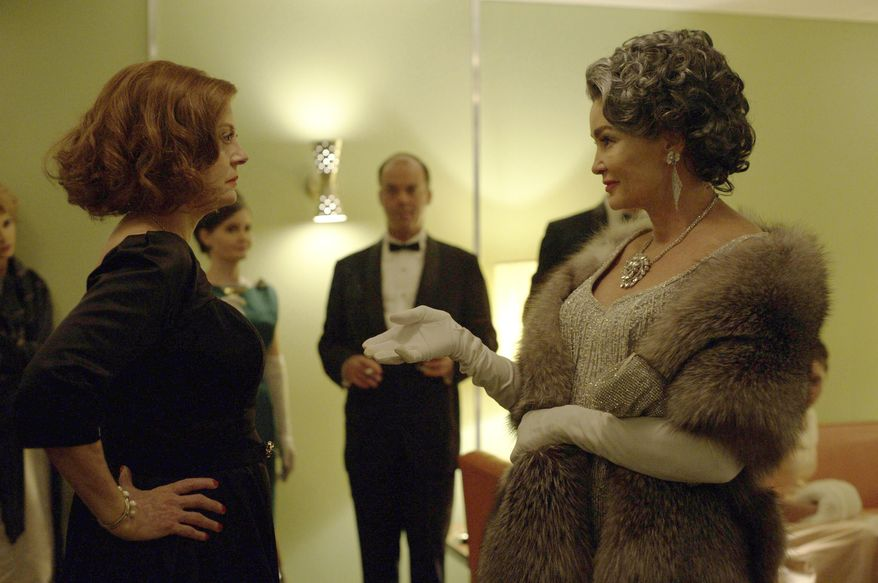 """This image released by FX shows Susan Sarandon as Bette Davis, left, and Jessica Lange as Joan Crawford in a scene from, """"Feud: Bette and Joan,"""" premiering on FX Sunday at 10 p.m. EST. (Suzanne Tenner/FX via AP)"""