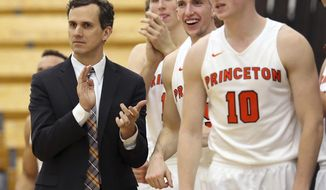 FILE -In this Nov. 25, 2016, file photo, Princeton coach Mitch Henderson applauds as he stands with his players during the second half of an NCAA college basketball game against Rowan in Princeton, N.J. Vermont and Princeton were the only teams in Division I to go unbeaten in the conference regular season this year. (AP Photo/Mel Evans, File)