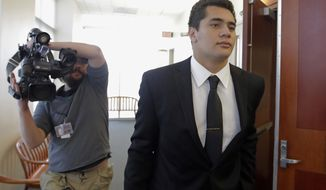 FILE - In this Oct. 14, 2016, file photo, Osa Masina, a suspended Southern California football player charged with rape in Utah, leaves the courtroom in Salt Lake City. Prosecutors in Los Angeles have decided not to file sexual assault charges against Masina, who is awaiting trial on similar charges in Utah. The LA County district attorney's office released documents on the decision Tuesday, March 7, 2017. (AP Photo/Rick Bowmer, File)