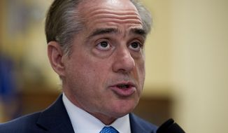 Secretary of Veterans Affairs David Shulkin, addresses the House Veterans' Affairs Committee's hearing on the Veterans Affairs community care program, on Captiol Hill in Washington, Tuesday, March 7, 2017. (AP Photo/Cliff Owen)