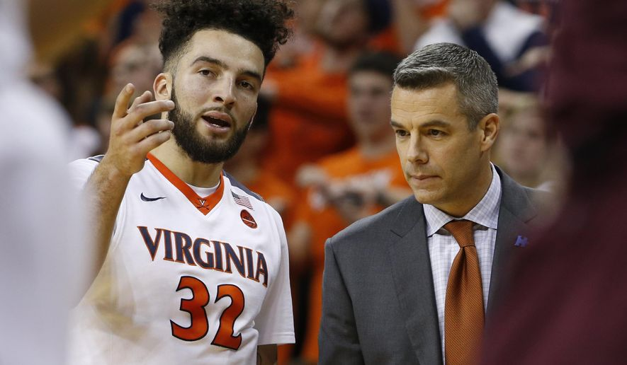 FILE - In this Feb. 1, 2017, file photo, Virginia guard London Perrantes (32) talks with head coach Tony Bennett during the second half of an NCAA college basketball game in Charlottesville, Va. The last two baskets Perrantes scored in a home game came off passes from Ty Jerome and Kyle Guy, the freshmen that will be charged with replacing him next season. But the Cavaliers' lone senior isn't ready to give up the reins just yet.(AP Photo/Steve Helber)
