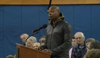 "Comedian Dave Chappelle joined residents in his hometown village of Yellow Springs, Ohio, to call for ""progressive law enforcement"" following a chaotic New Year's Eve altercation that led to the police chief's resignation. (YouTube/@WKEFandWRGT)"