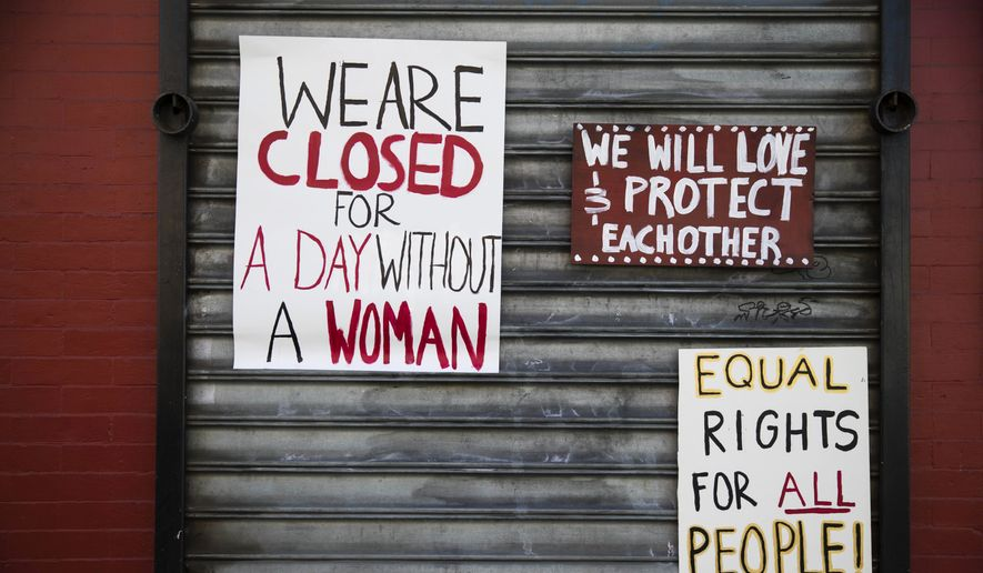 """Signs are posted at the Grindcore House restaurant shuttered in solidarity with """"A Day Without a Woman"""" in Philadelphia, Wednesday, March 8, 2017. Organizers of January's Women's March are calling on women to stay home from work and not spend money in stores or online to show their impact on American society. (AP Photo/Matt Rourke)"""