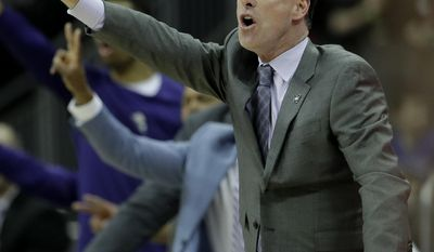 TCU head coach Jamie Dixon talks to his players during the first half of an NCAA college basketball game against Oklahoma in the Big 12 Conference tournament Wednesday, March 8, 2017 in Kansas City, Mo. (AP Photo/Charlie Riedel)