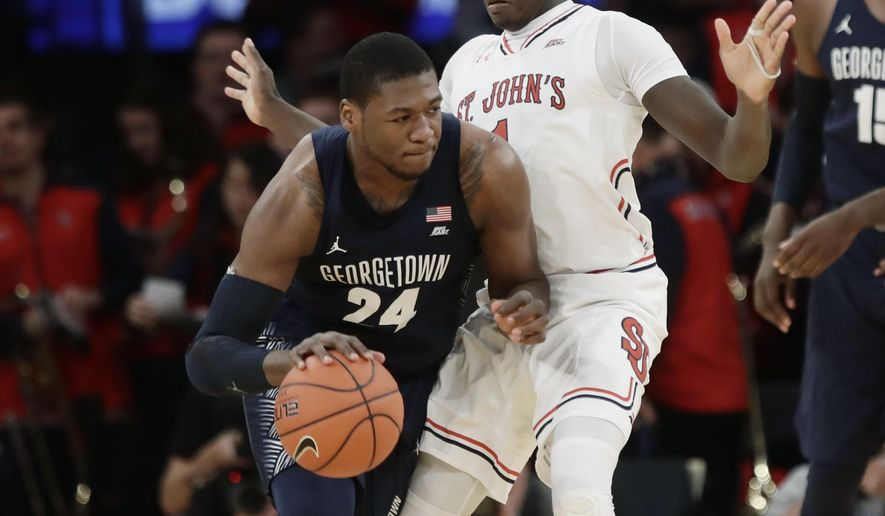 St. John's Bashir Ahmed (1) defends Georgetown's Marcus Derrickson (24) during the first half of an NCAA college basketball game during the Big East men's tournament Wednesday, March 8, 2017, in New York. (AP Photo/Frank Franklin II) **FILE**