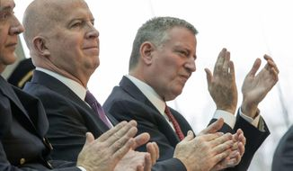 In this Jan. 4, 2017 file photo, New York City Mayor Bill de Blasio, right, and NYPD Commissioner Jim O'Neil appear at a news conference in New York. (AP Photo/Mary Altaffer, File)