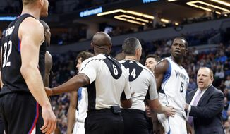 Officials keep Los Angeles Clippers' Blake Griffin, left, and Minnesota Timberwolves' Gorgui Dieng of Senegal separated as Timberwolves head coach Tom Thibodeau, right, enters the scene after the two players exchanged words during the first half of an NBA basketball game Wednesday, March 8, 2017, in Minneapolis. A double technical was called on both. (AP Photo/Jim Mone)