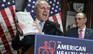 "House Majority Whip Steve Scalise of La., left, joined by Rep. Phil Roe, R-Tenn., holds up a copy of the original Affordable Care Act bill during a news conference on Capitol Hill in Washington, Wednesday, March 8, 2017, as the GOP leadership talks about its work on the long-awaited Republican plan to repeal and replace ""Obamacare."" (AP Photo/J. Scott Applewhite)"