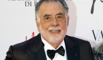 """FILE - In this May 22, 2016 file photo, director Francis Ford Coppola poses for photographers as he arrives for the premiere of Verdi's """"La Traviata'' at the Rome Opera House, in Rome. The 16th Tribeca Film Festival will close with a """"Godfather"""" cast reunion and a back-to-back screening of parts one and two of Coppola's classic saga. Tribeca announced Wednesday, March 8, 2017, that the 45th anniversary screenings will be followed by a conversation with Coppola, Al Pacino, Diane Keaton, Robert Duvall, James Caan, Talia Shire and festival co-founder Robert De Niro. (AP Photo/Andrew Medichini, File)"""