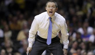 FILE - In this Saturday, March 4, 2017, file photo, Florida head coach Mike White yells to his players in the second half of an NCAA college basketball game against Vanderbilt in Nashville, Tenn. How far Florida goes in the Southeastern Conference Tournament likely will determine how far it has to go to start NCAA play. The 17th-ranked Gators probably need a win in Nashville on Friday, March 10, to lock up a top-four seed in the NCAA Tournament. (AP Photo/Mark Humphrey, File)