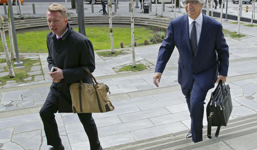Mark Rosenbaum, right, an attorney for Daniel Ramirez Medina, arrives at the federal courthouse in Seattle, Wednesday, March 8, 2017 for a hearing for Medina, a Seattle-area man who was arrested and detained by immigration agents despite his participation in a federal program to protect those brought to the U.S. illegally as children. (AP Photo/Ted S. Warren)