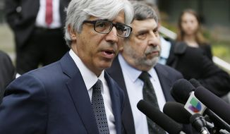 Theodore Boutrous Jr., left, and Mark Rosenbaum, right, attorneys for Daniel Ramirez Medina, talk to reporters at the federal courthouse in Seattle, Wednesday, March 8, 2017, following a hearing for Medina, a Seattle-area man who was arrested in February and detained by immigration agents despite his participation in a federal program to protect those brought to the U.S. illegally as children. A federal magistrate said Wednesday that he expects to rule early next week on whether to release Medina. (AP Photo/Ted S. Warren)