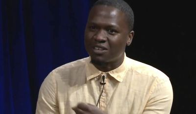 In this undated image taken from BRIC TV video, journalist Juan Thompson speaks while appearing on a panel in New York, which was discussing racism. Thompson, who is accused of making bomb threats to several Jewish centers across the country, faces a hearing in federal court in Missouri on Wednesday, March 8, 2017, to determine whether he can be released on bail. (BRIC TV via AP)
