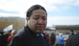 Democratic Sen. Kevin Killer, a member of the Oglala Sioux Tribe, stands after speaking to a group of Keystone XL pipeline opponents in Pierre, S.D., Wednesday, March 8, 2017. (AP Photo/James Nord)