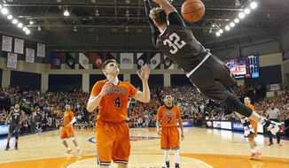 Lehigh's Tim Kempton (32) dunks over Bucknell's Nate Sestina (4) during the first half of an NCAA college basketball Patriot League Championship game in Lewisburg, Pa., Wednesday, March 8, 2017. (AP Photo/Chris Knight)