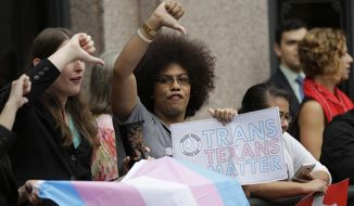 "Nicole Perry joins other members of the transgender community who oppose Senate Bill 6 in a protest at the Texas Capitol as the Senate State Affairs Committee holds hearings on the bill, Tuesday, March 7, 2017, in Austin, Texas. The transgender ""bathroom bill"" would require people to use public bathrooms and restrooms that correspond with the sex on their birth certificate. (AP Photo/Eric Gay) ** FILE **"