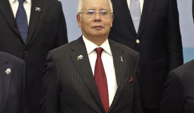 "Malaysia's Prime Minister Najib Razak poses for a group photo at the Indian Ocean Rim Association (IORA) summit in Jakarta, Indonesia, Tuesday, March 7, 2017. The bitter diplomatic dispute between North Korea and Malaysia over the poisoning death of leader Kim Jong Un's estranged half-brother escalated dramatically Tuesday, with Pyongyang saying it had banned Malaysians from leaving North Korea. Najib in a statement said North Korea is ""effectively holding our citizens hostage"" by barring them from leaving. (AP Photo/Dita Alangkara)"