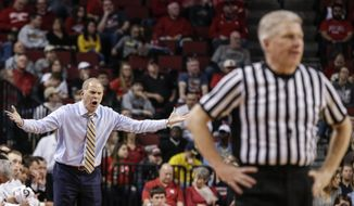 Michigan coach John Beilein disputes a call by the referee during the second half of an NCAA college basketball game against Nebraska in Lincoln, Neb., Sunday, March 5, 2017. Michigan won 93-57. (AP Photo/Nati Harnik)