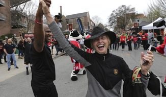 This March 5, 2017 photo shows Atlanta United RC fan Barbara Morningstar dancing with MC Leighton outside Bobby Dodd Stadium before the first game in franchise history against the New York Red Bull in Atlanta. After the opening weekend of Major League Soccer, it looks as though Atlanta is doing everything right. Now all the team needs a first victory. It could come Sunday, March 12, 2017 against the league's other expansion team and another United, Minnesota, at TCF Bank Stadium in Minneapolis. (Curtis Compton/Atlanta Journal-Constitution via AP)