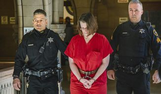 Laurel Schlemmer, who is accused of drowning two of her sons, is escorted to the courtroom at the Allegheny County Courthouse to appear for her nonjury trial before Judge Jeffrey A. Manning, Wednesday, March 8, 2017. Ms. Schlemmer is accused of drowning her sons Luke, 3, and Daniel, 6, in the bathtub of their McCandless, Pa., home on April 1, 2014. (Andrew Rush/Pittsburgh Post-Gazette via AP)