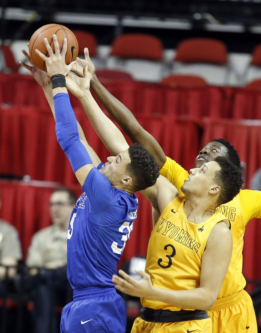 Air Force's Hayden Graham, left, Wyoming's Alexander Aka Gorski, of Sweden, (3) and Alan Herndon reach for a rebound during the second half of an NCAA college basketball game in the Mountain West Conference tournament Wednesday, March 8, 2017, in Las Vegas. Air Force defeated Wyoming 83-68. (AP Photo/Isaac Brekken)