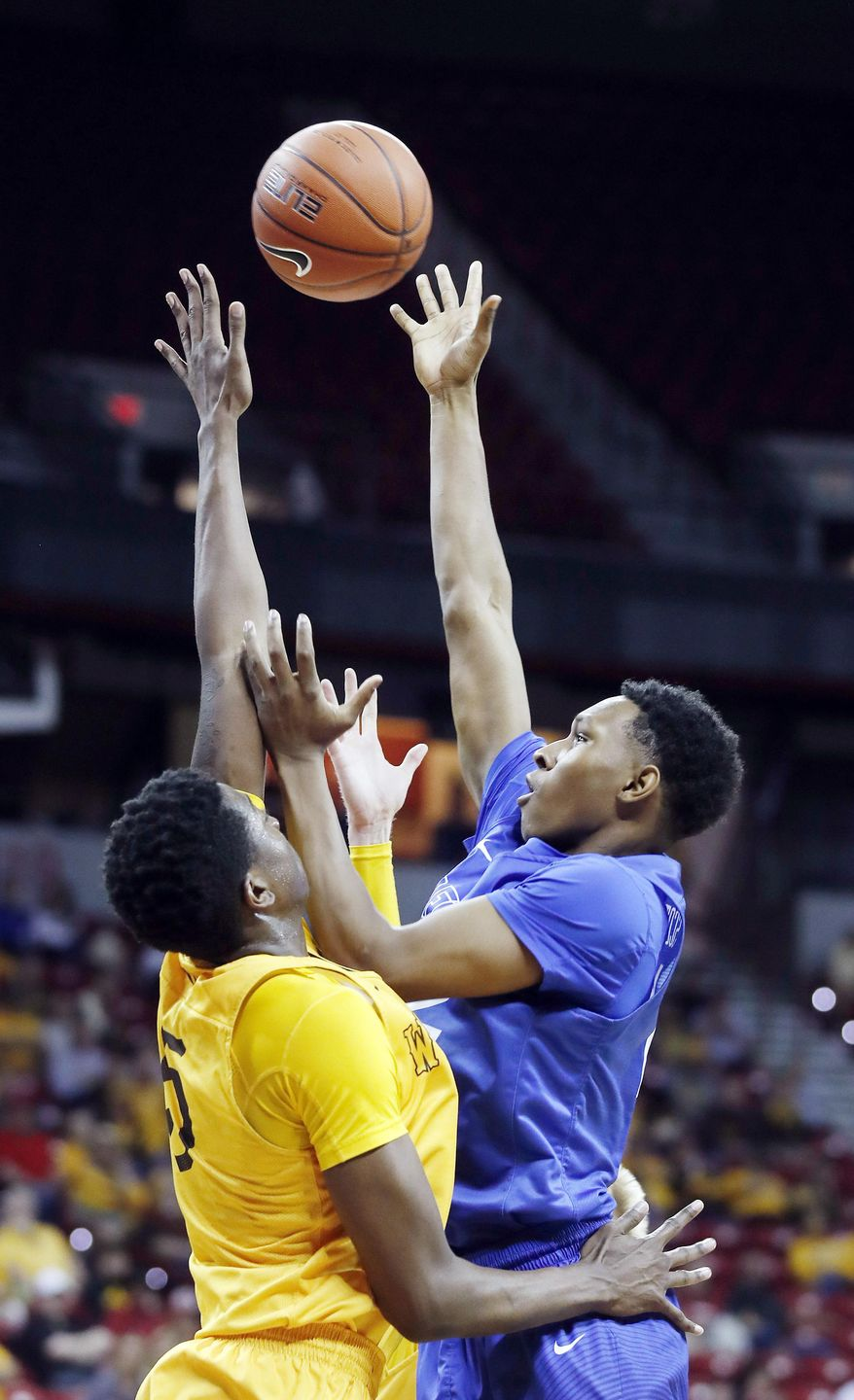 Air Force's Lavelle Scottie shoots as Wyoming's Alan Herndon defends during the second half of an NCAA college basketball game in the Mountain West Conference tournament Wednesday, March 8, 2017, in Las Vegas. Air Force defeated Wyoming 83-68. (AP Photo/Isaac Brekken)