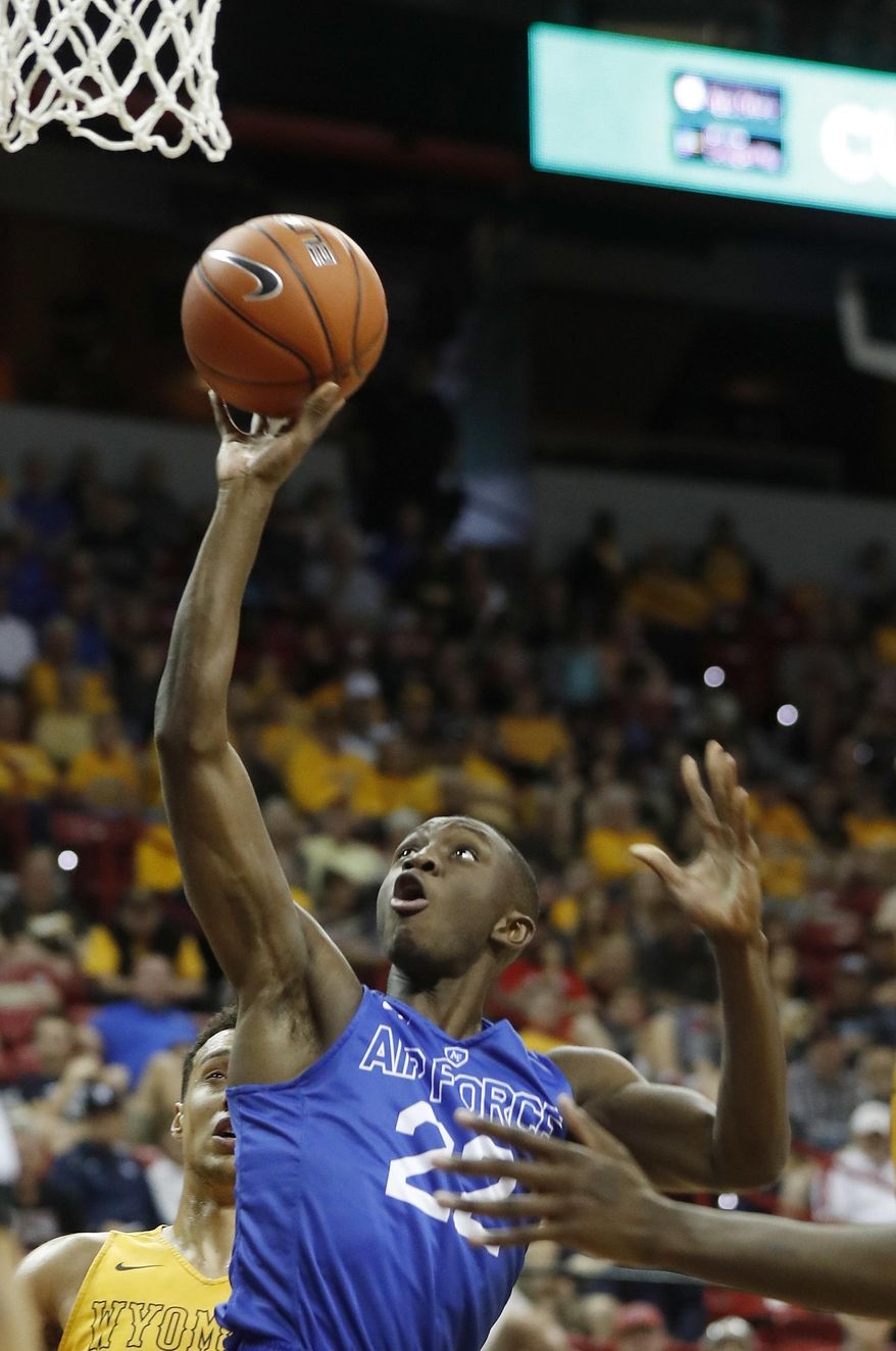 Air Force's Pervis Louder shoots during the second half of an NCAA college basketball game against Wyoming in the Mountain West Conference tournament Wednesday, March 8, 2017, in Las Vegas. Air Force defeated Wyoming 83-68. (AP Photo/Isaac Brekken)