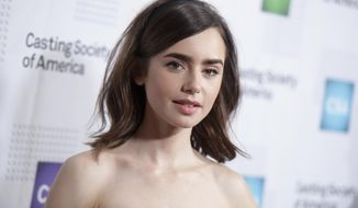 FILE - In this Jan. 19, 2017, file photo, Lily Collins arrives at the 32nd annual Artios Awards at the Beverly Hilton Hotel in Beverly Hills, Calif. Collins has forgiven her father, Phil Collins, in a new book of essays released on March 7, 2017. (Photo by Richard Shotwell/Invision/AP, File)