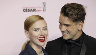 In this Feb. 28, 2014, file photo, U.S. actress Scarlett Johansson, left, and her partner Romain Dauriac arrive at the 39th French Cesar Awards Ceremony, in Paris. Dauriac's lawyer confirmed to The Associated Press that Johansson filed for divorce from Dauriac on March 7, 2017, in New York,. (AP Photo/Lionel Cironneau, File)