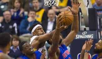 Indiana Pacers center Myles Turner (33) knocks the ball away from Detroit Pistons center Andre Drummond (0) as he tries to pull in a rebound during the first half of an NBA basketball game in Indianapolis, Wednesday, March 8, 2017. (AP Photo/Doug McSchooler)