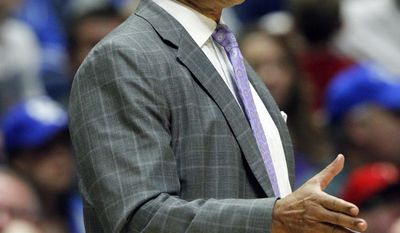 LSU coach Johnny Jones yells to his team during the first half of an NCAA college basketball game against Mississippi State at the Southeastern Conference tournament Wednesday, March 8, 2017, in Nashville, Tenn. (AP Photo/Wade Payne)